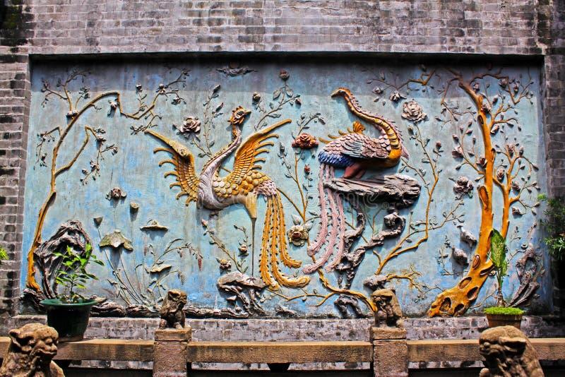 Phoenix vägg som snider i Lin Fung Temple, Macao, Kina arkivbild