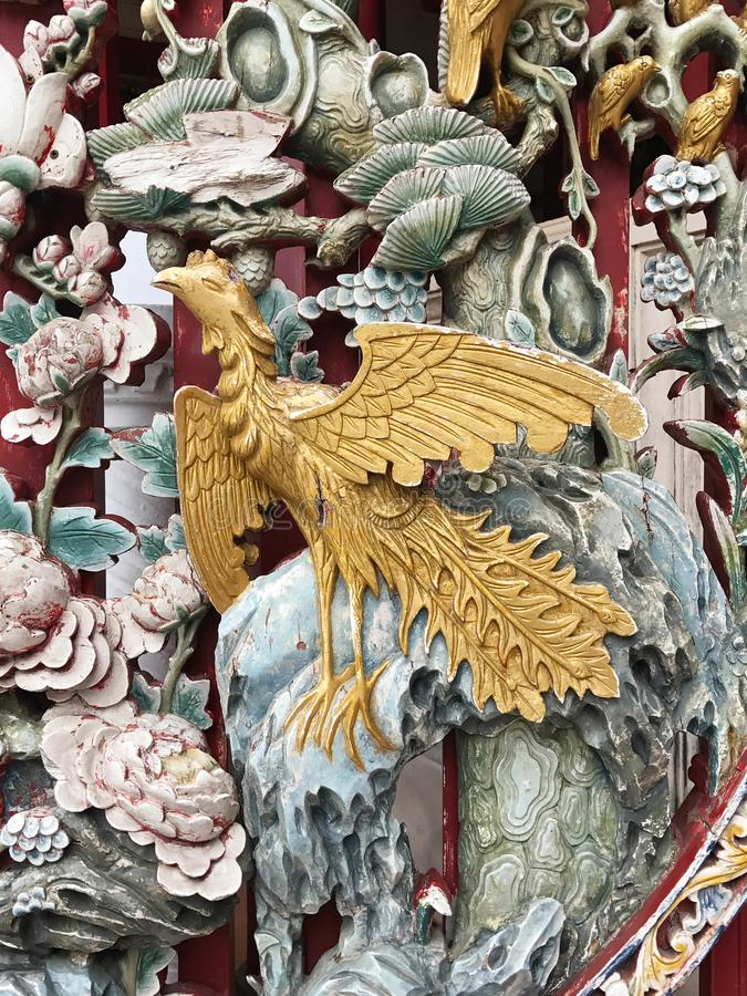 Phoenix wood carving in Chinese temple stock images
