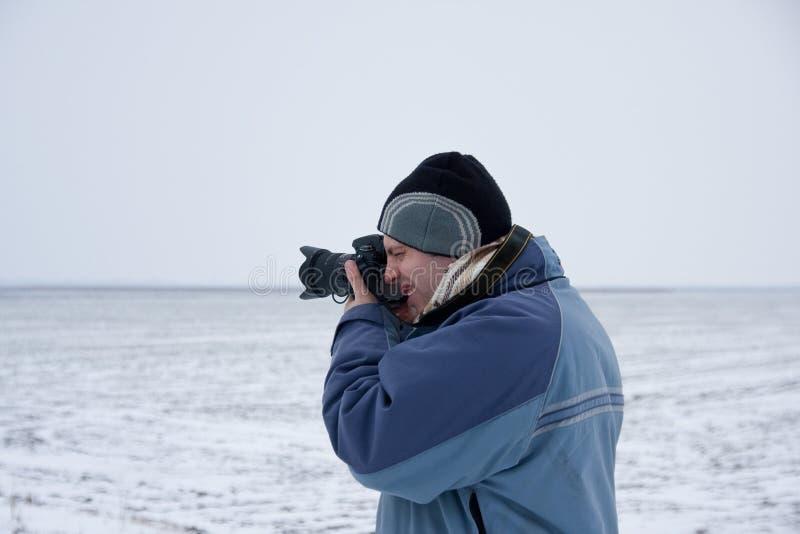 Phographer en hiver 3 image libre de droits