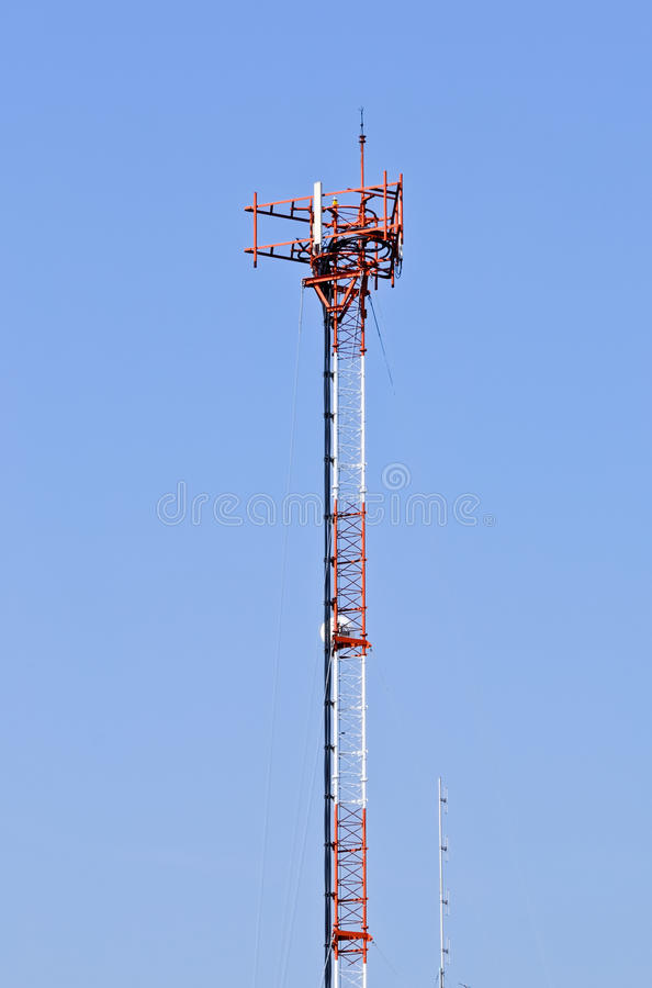 Phone antenna pole. On the roof of building stock image