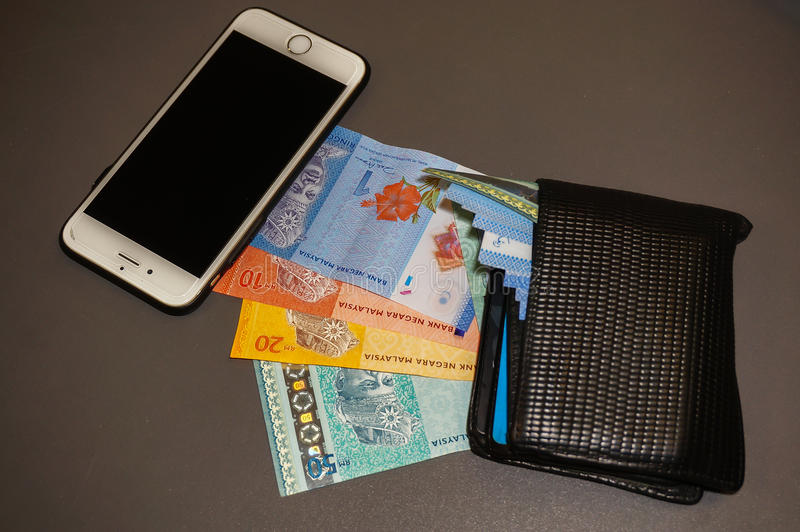 Phone, bank notes and wallet stock photo