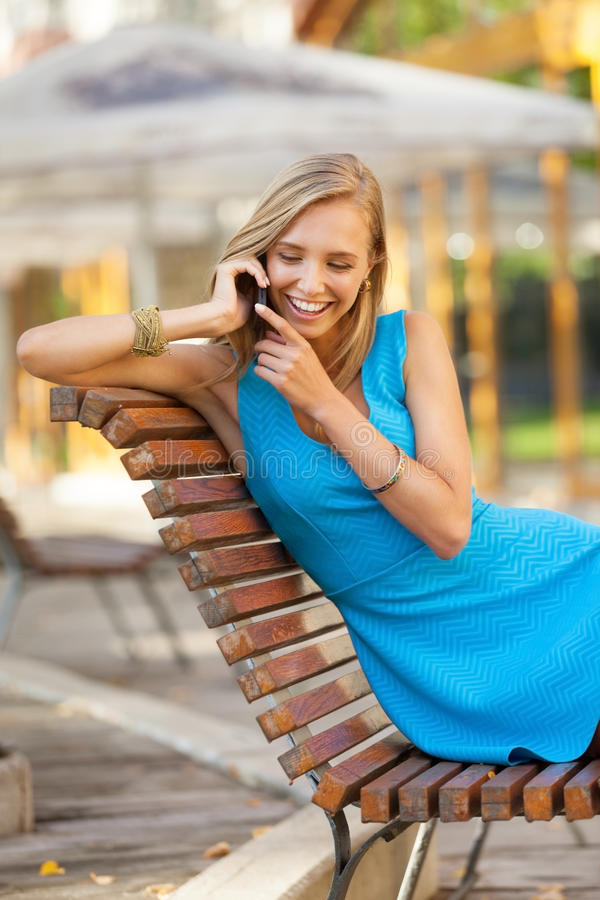 On the phone. Beautiful girl on the phone stock images