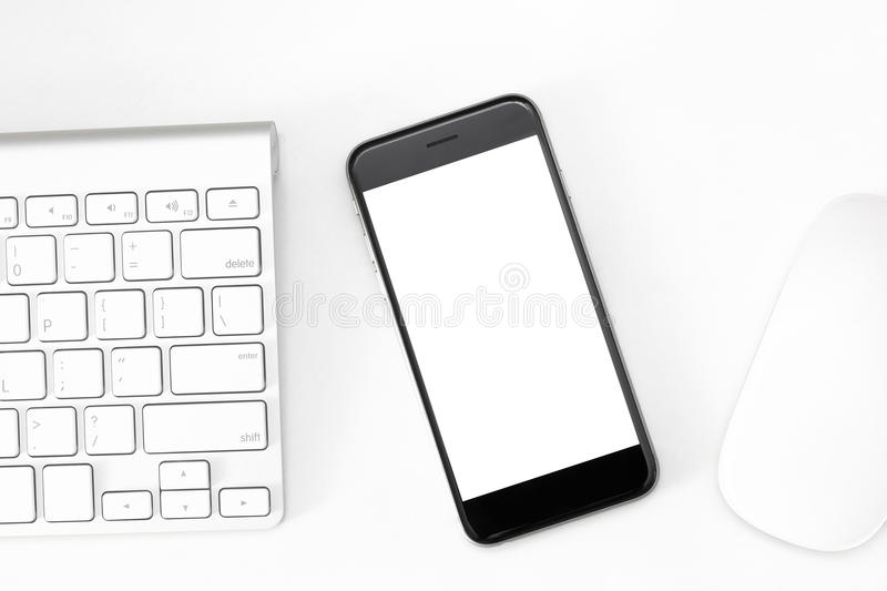 Phone blank screen on work table. Phone blank screen on white work table stock image