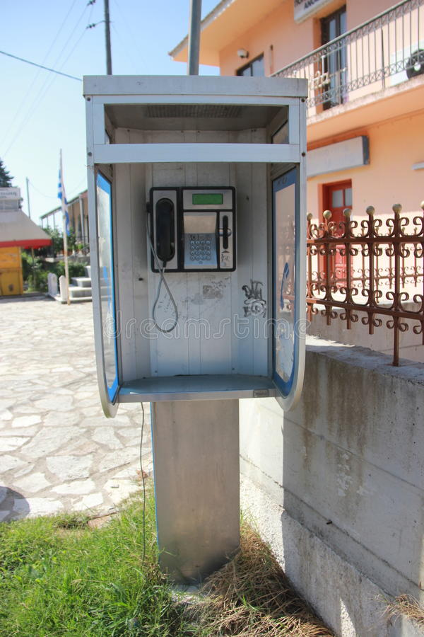 Phone booth in greece royalty free stock images