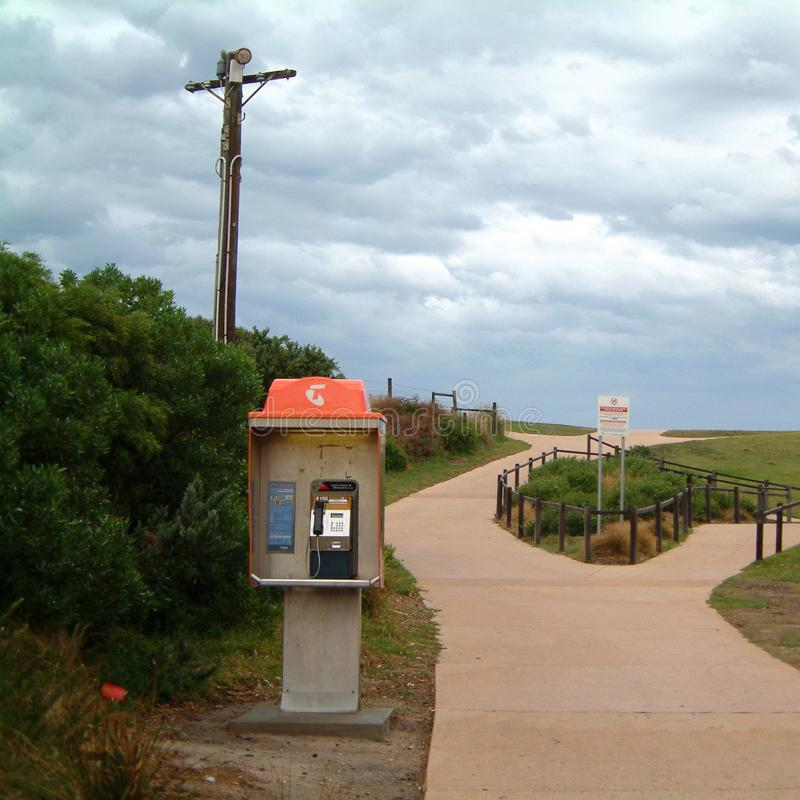 Phone booth in Torquay beach stock image