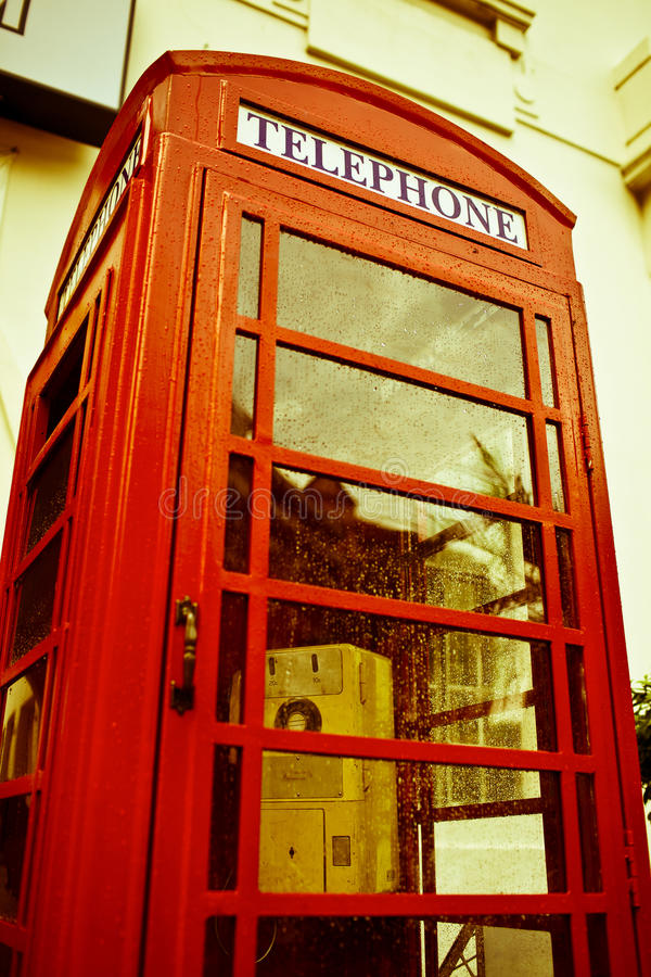 Phone box. English style red phone box royalty free stock photography