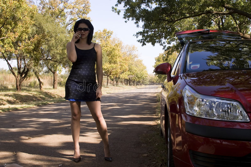 Download On the phone breakdown stock photo. Image of female, roadside - 2327270