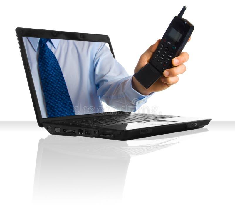 Phone call. A hand through a laptop giving a phone