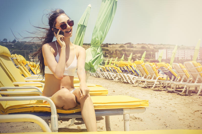 Download Phone call at the beach stock image. Image of body, sunlight - 63571021