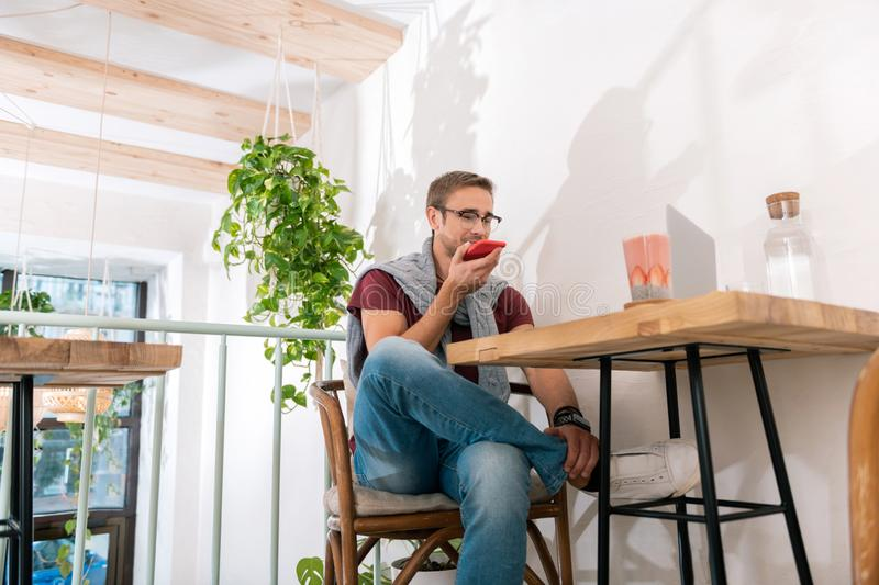 Handsome entrepreneur having important phone call with business partner. Phone call. Handsome stylish smart entrepreneur having important phone call with stock images