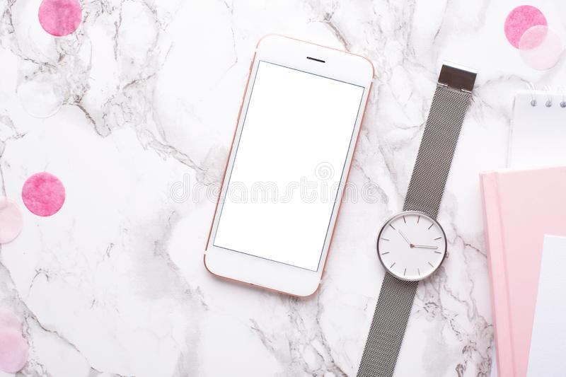 Phone with a clock on a marble background in the office royalty free stock photography