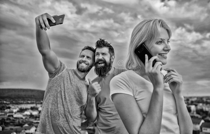 Phone. Close up of a group of young people with smartphones. Fri stock photos