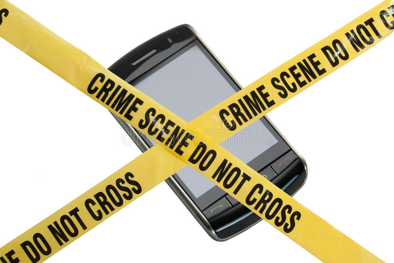 Phone Crime Scene. A smart phone is blocked by yellow police tape reading Crime Scene Do Not Cross. The concept represents compromised technology, identity theft royalty free stock images