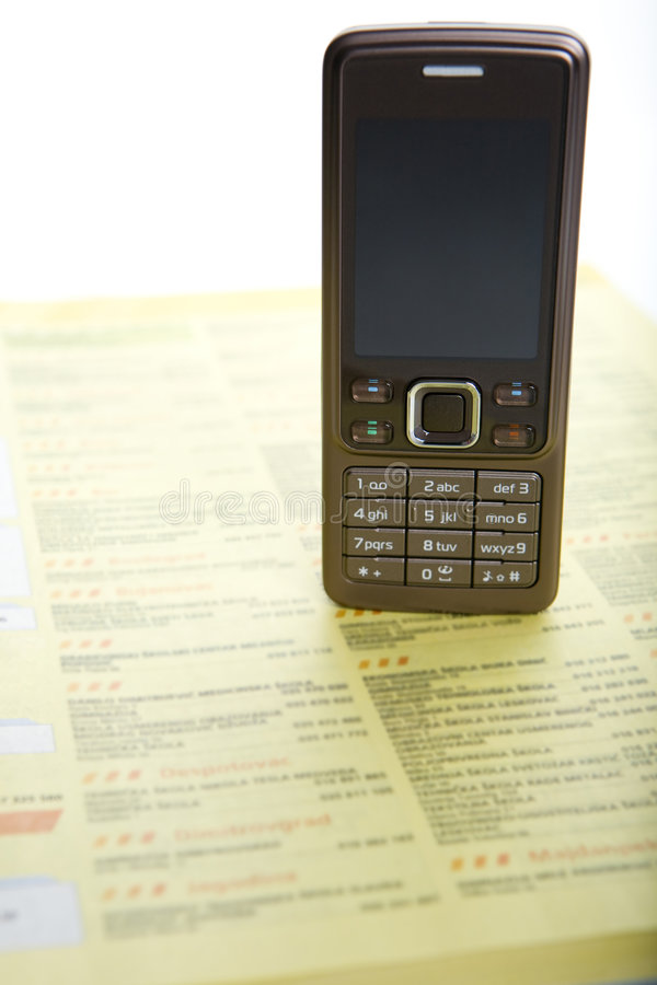 Phone directory. Open directory and mobile phone royalty free stock photos