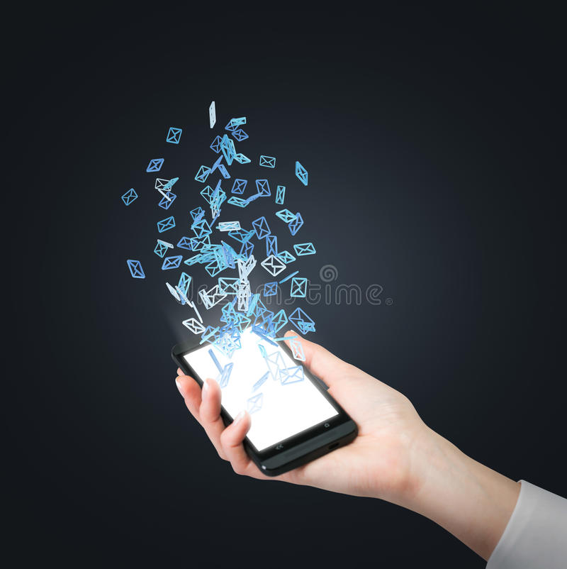Phone with flying email sign royalty free stock images
