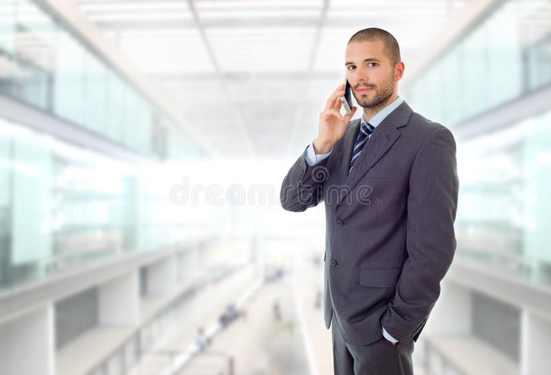 On the phone. Happy business man on the phone, at the office royalty free stock photos