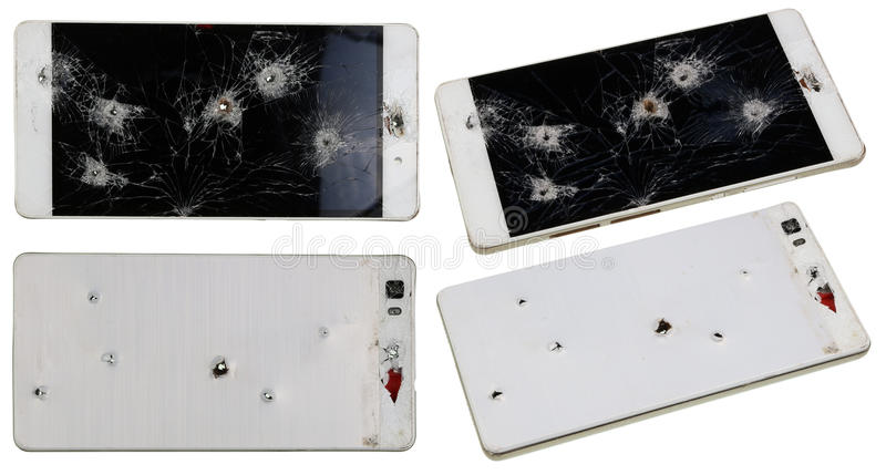 Phone with holes from nails and bullets stock photo