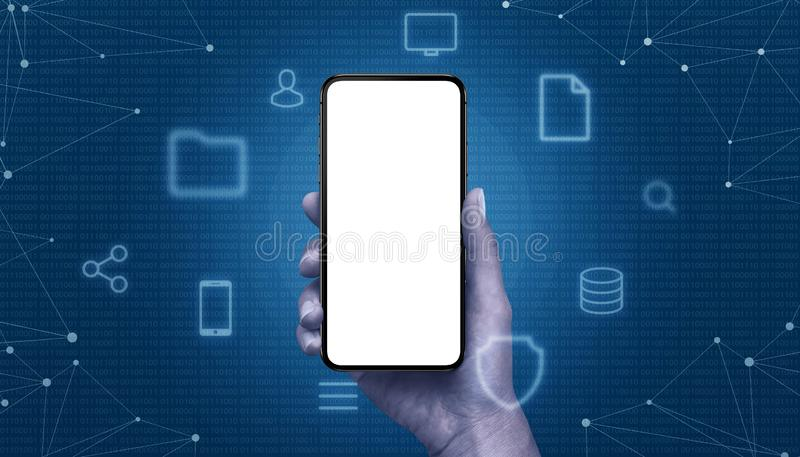 Phone mockup in hand surrounded with computing icons and metwork threads. Binary code in background royalty free stock image
