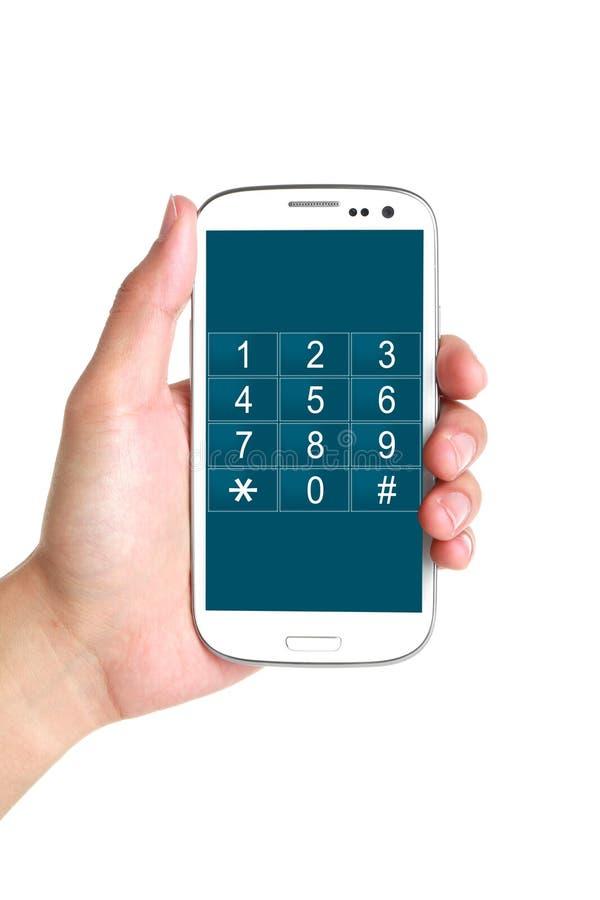 Phone number key pad on smartphone. Phone number key pad buttons on smartphone in hand isolated on white stock photos