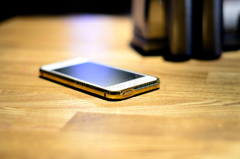 Phone от a table stock image