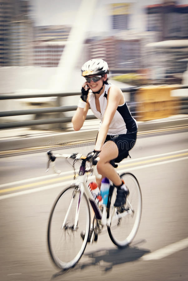 Download On the Phone, While Riding editorial photo. Image of female - 17484281