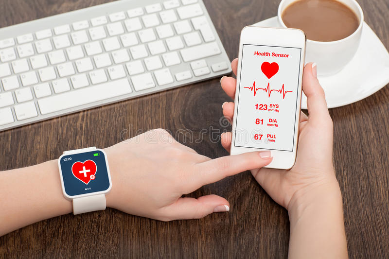 Phone and smart watch with mobile app health sensor stock images
