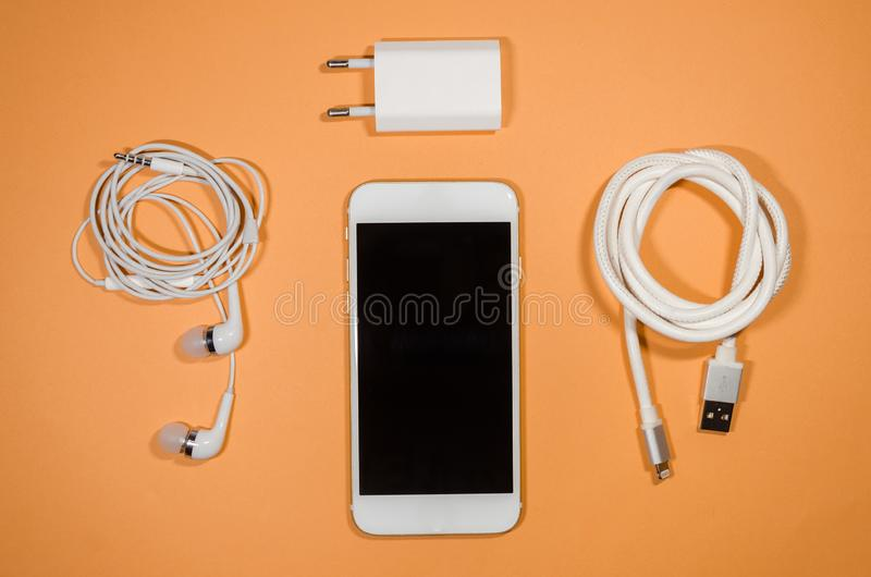 A phone with usb cable and headphones stock photos