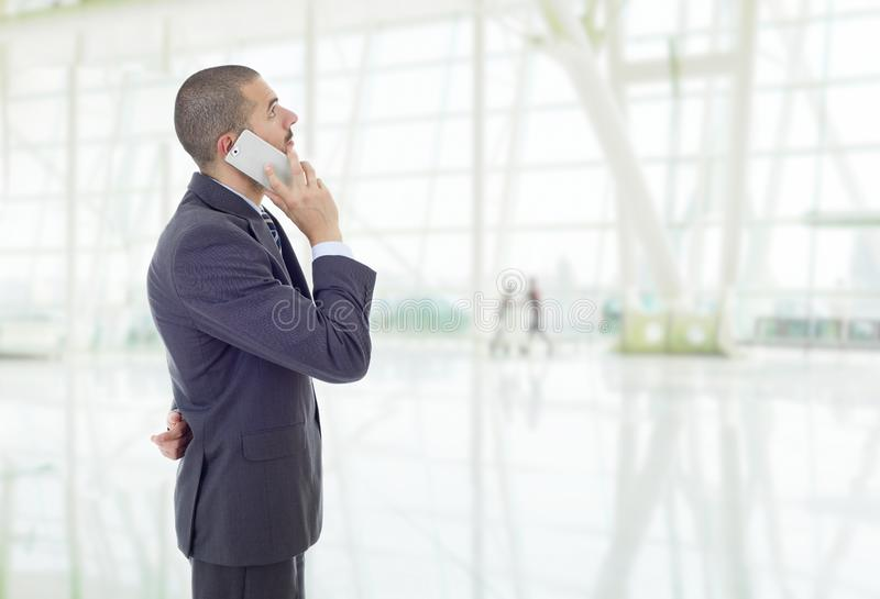 On the phone. Worried business man on the phone, at the office royalty free stock photos