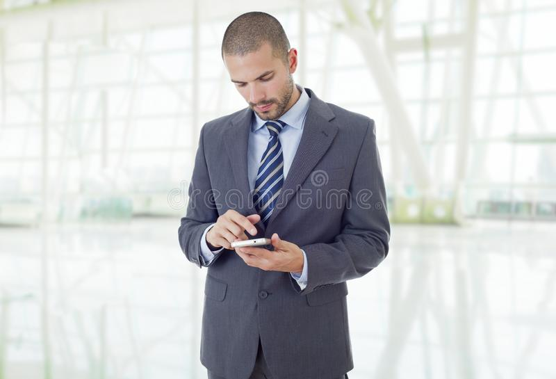On the phone. Worried business man on the phone, at the office stock image