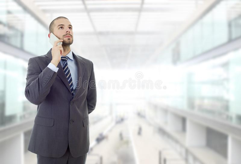 On the phone. Worried business man on the phone, at the office stock photos