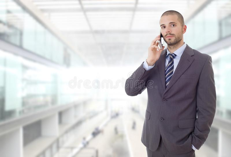 On the phone. Worried business man on the phone, at the office royalty free stock image