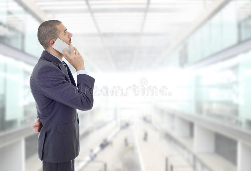 On the phone. Worried business man on the phone, at the office stock photo