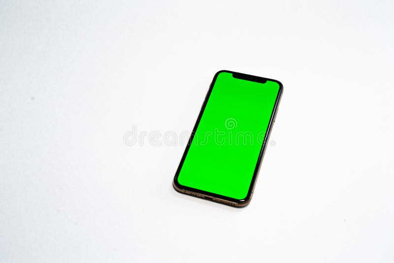 Phone XS, Phone smartphone, green screen on white background stock photography