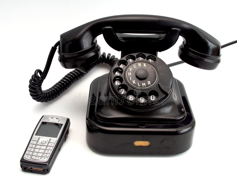 Phones. Vintage phone and cellphone stock photo