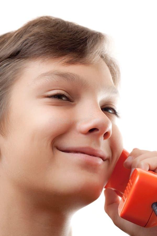phones schoolboywhith arkivbild
