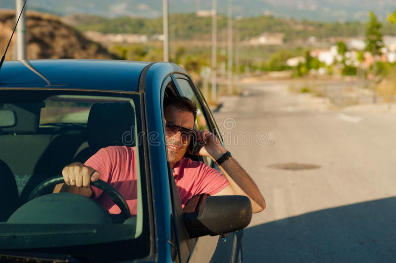 Phoning while driving royalty free stock photography