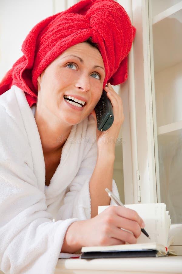 Phoning Pampered Woman Royalty Free Stock Image
