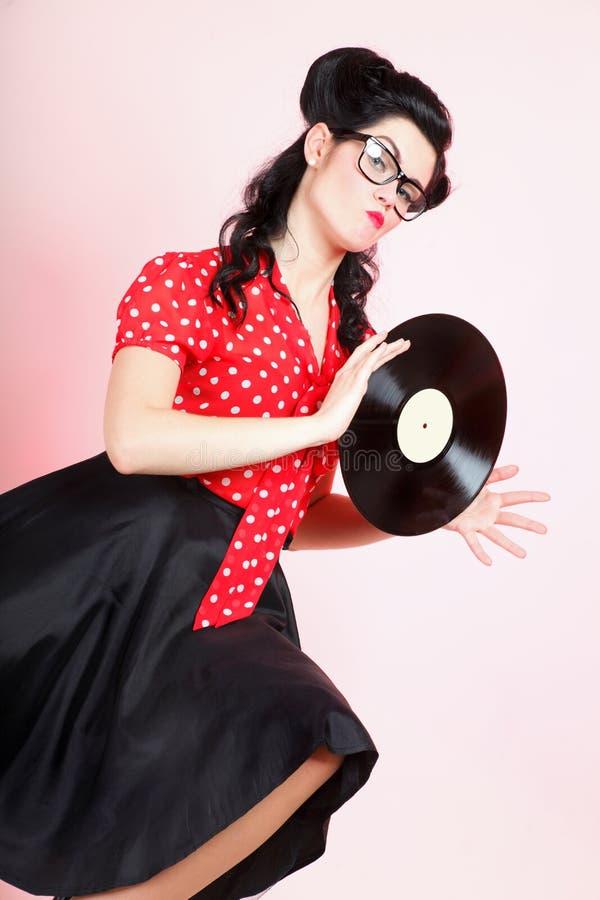 Phonography-Entsprechungsaufzeichnung Mädchenstift-oben Retro- lizenzfreies stockfoto