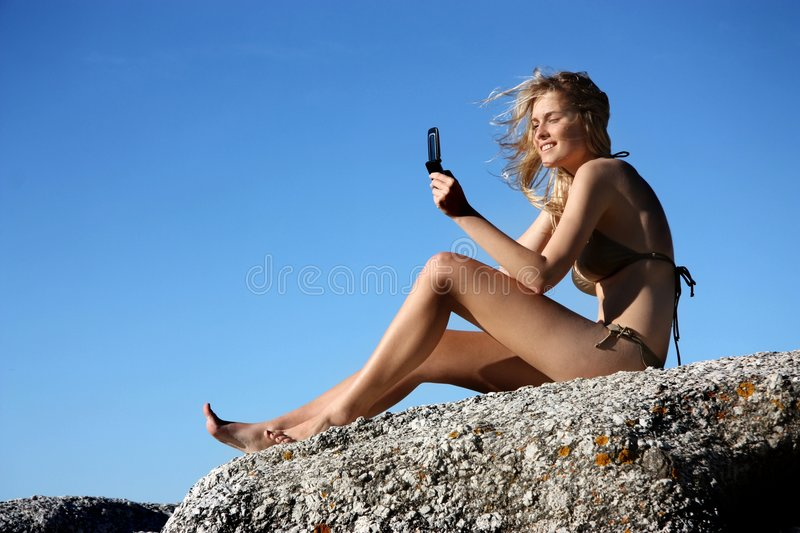 Photo. Young woman doing a photo with her mobile phone in summertime stock photos