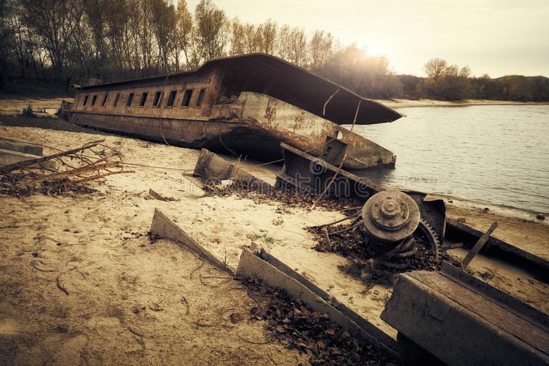 Abandoned shipwreck. Photo of an Abandoned shipwreck on the shore stock photography