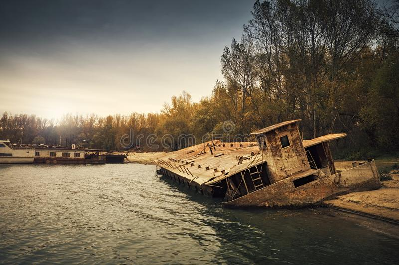 Abandoned shipwreck. Photo of an Abandoned shipwreck on the shore royalty free stock photo