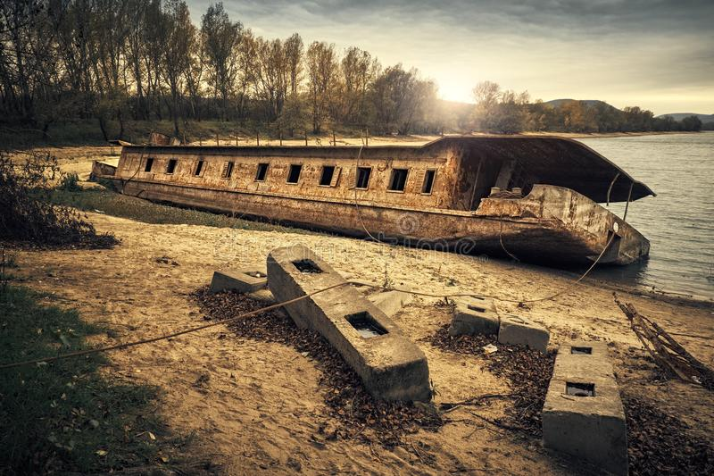 Abandoned shipwreck. Photo of an Abandoned shipwreck on the shore stock images