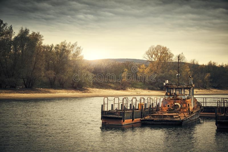Abandoned shipwreck. Photo of an Abandoned shipwreck on the shore stock photo