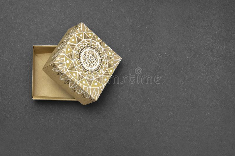 Photo from above with place for text. Vintage Christmas, Valentine background with the kraft golden mandala hand painted gift. Boxes, top view with copy space royalty free stock image