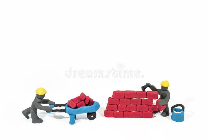 Photo abstraite des travaux de bâtiments Figures faites à partir de l'argile de jeu images stock