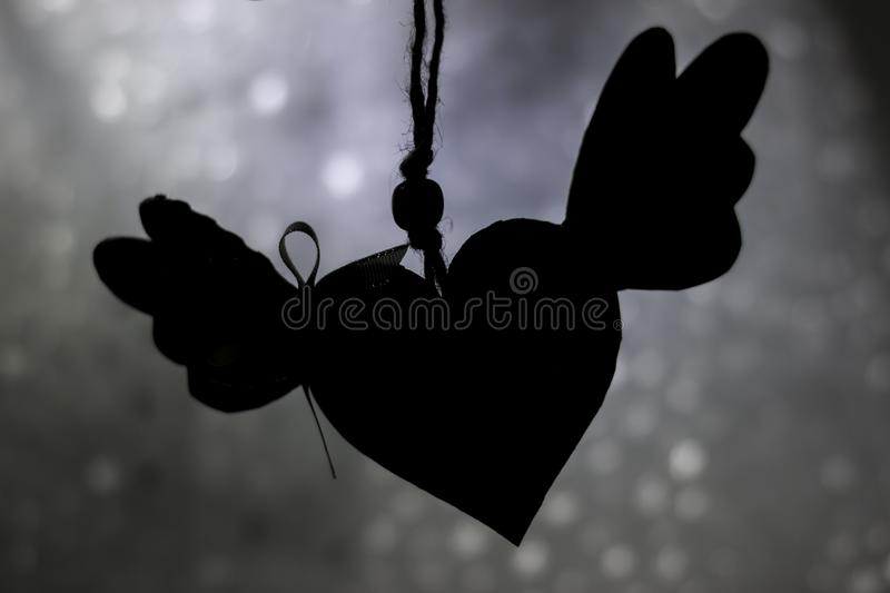 Black heart with wings stock images