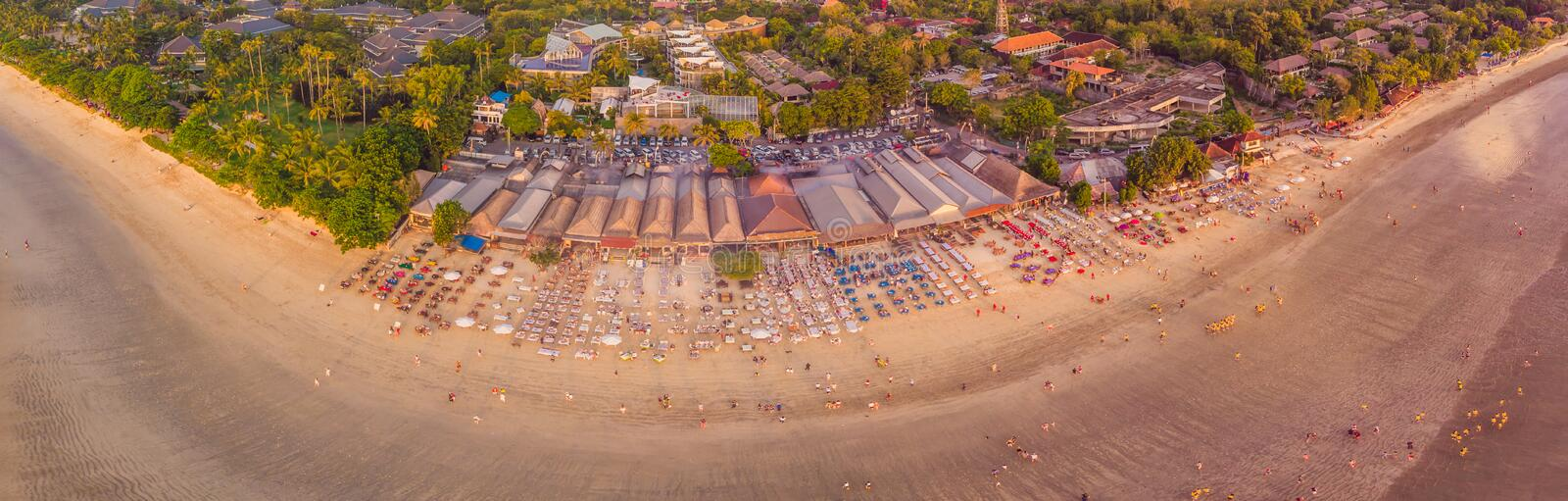 Photo from the air, from the drone Balinese Jimbaran beach famous for it`s perfect sea food restaurants.  royalty free stock images
