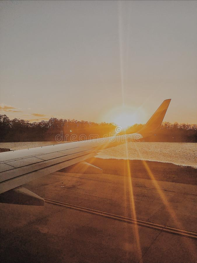 Photo of Airplane Wing during Golden Hour royalty free stock images