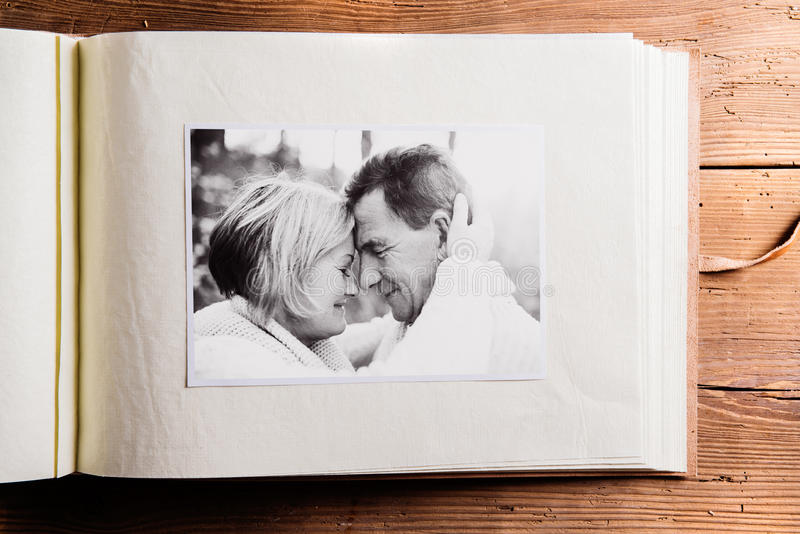 Download photo album with black and white picture of senior couple stock image