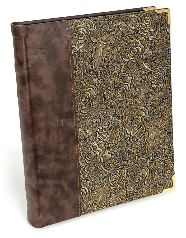 Photo album with eco leather ant textile floral pattern. Golden luxury lace texture book with roses. Isolated background royalty free stock photo